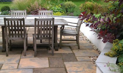 Back Garden Seating Area with steps to Lawn
